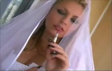 Sexy bride smoking a cig before the wedding