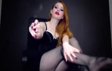 Redhead babe with a smoking fetish