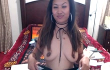 Asian BBW babe smoking while posing in lingerie