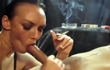 Smoking a cigarette while sucking big cock
